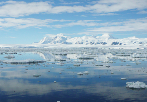 Scene of ice-covered mountains and sea ice
